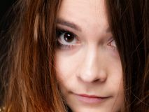 Closeup woman covers the face by long brown hairs Royalty Free Stock Photo