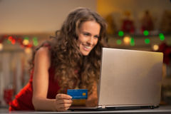 Closeup on woman with credit card using laptop Stock Image