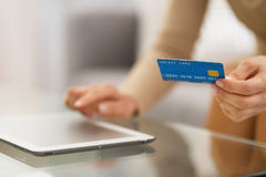 Closeup on woman with credit card using tablet pc Royalty Free Stock Images