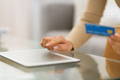 Closeup on woman with credit card using tablet pc Royalty Free Stock Photography