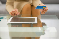 Closeup on woman with credit card using tablet pc Stock Photography