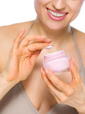 Closeup on woman with creme Stock Photography