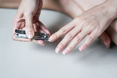Closeup Woman Cutting her Nails Royalty Free Stock Images