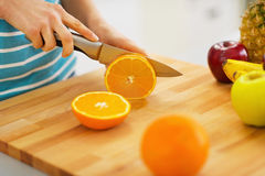 Closeup on woman cutting orange Royalty Free Stock Photo