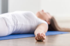 Closeup of woman in Dead Body pose, fingers in focus Stock Images
