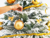 Closeup on woman decorating christmas tree with christmas ball Stock Photo