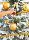 Closeup on woman decorating christmas tree with christmas ball Royalty Free Stock Photo