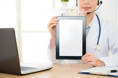 Closeup of woman doctor with blank area. Closeup of woman doctor calling online and using digital tablet with blank area mobile can be add some texts or others Stock Photography