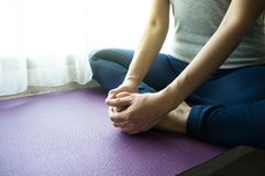 Closeup female doing yoga by butterfly stretch. Closeup woman doing yoga by butterfly stretch stock photos