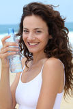 Closeup of woman drinking from bottle Stock Photo
