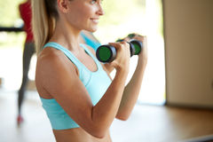 Closeup of woman with dumbbells in gym Royalty Free Stock Photos