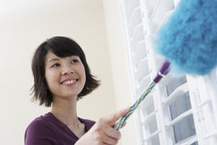 Closeup Of Woman Dusting Stock Image