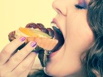 Closeup woman eating fruit cake sweet food Royalty Free Stock Photo