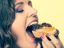 Closeup woman eating fruit cake sweet food Stock Photography