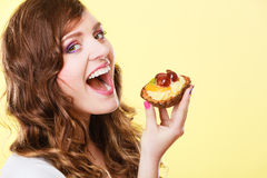 Closeup woman eating fruit cake sweet food Stock Photo