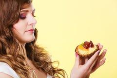 Closeup woman eating fruit cake sweet food Royalty Free Stock Image