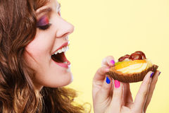 Closeup woman eating fruit cake sweet food Stock Image