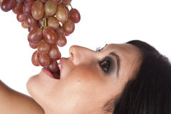 Closeup of woman eating grapes. Stock Photo