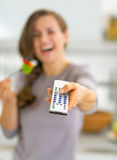 Closeup on woman eating salad and watching tv Royalty Free Stock Photography