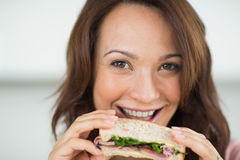 Closeup of a woman eating sandwich Royalty Free Stock Image