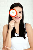 Closeup of woman eating. Smiling happy women with candy. Stock Photography