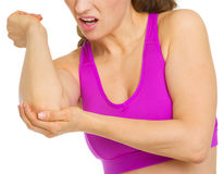 Closeup on woman with elbow pain. Isolated on white Royalty Free Stock Photo