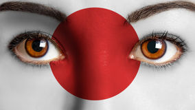 Closeup woman eyes japanese flag painted face. Stock Photography