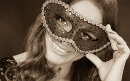Closeup woman face with carnival mask on dark Royalty Free Stock Image