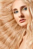 Closeup woman face with curly hair Stock Image
