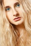 Closeup woman face with curly hair Royalty Free Stock Photos