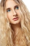 Closeup woman face with curly hair vertical Royalty Free Stock Photo
