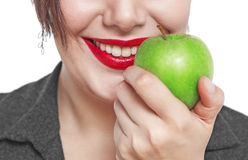 Closeup of the woman face with green apple isolated Royalty Free Stock Images