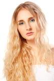 Closeup woman face with long curly hair Stock Photos