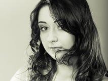 Closeup woman face long curly hair portrait Stock Images
