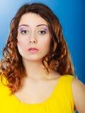 Closeup woman face long curly hair portrait Royalty Free Stock Photos