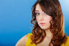 Closeup woman face long curly hair portrait Stock Photography