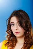Closeup woman face long curly hair portrait Stock Photos