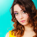Closeup woman face long curly hair portrait Royalty Free Stock Images