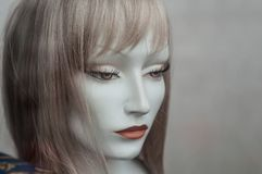 Woman face of mannequin with wig in fashion store sho Royalty Free Stock Photo