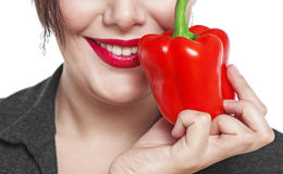 Closeup of the woman face with red pepper isolated Stock Image