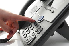 Closeup of woman finger  dialing a telephone number to make a ph Royalty Free Stock Photos