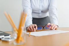 Closeup of a woman freelancer works in the office at the table. Stock Photo