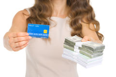 Closeup on woman giving credit card and money. Packs Royalty Free Stock Images