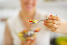 Closeup on woman giving spoon with fruits salad Stock Images