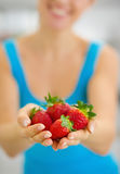 Closeup on woman giving strawberries Royalty Free Stock Images