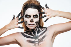 Closeup of woman with gothic terrifying makeup posing. Over white background Stock Photos