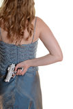 Closeup woman with gun behind back Stock Image