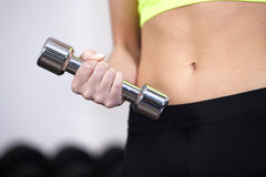 Closeup of woman at the gym lifting free weights Stock Photography