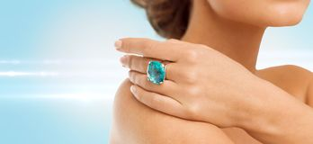 Closeup of woman hand with big blue cocktail ring Stock Image