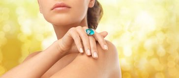 Closeup of woman hand with big blue cocktail ring Stock Photos